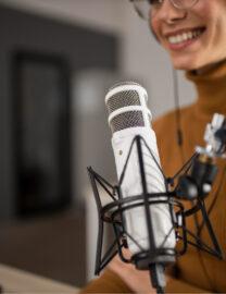 woman-broadcasting-radio-while-smiling-1