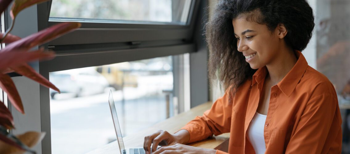 happy-african-american-woman-copywriter-working-freelance-project-from-home-businesswoman-using-laptop-searching-information-website-successful-business-online-training-courses-concept-scaled