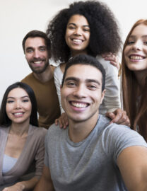 group-happy-young-people-taking-selfie-scaled